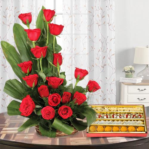 Splendid 18 Red Roses along with mouth-watering Sweets