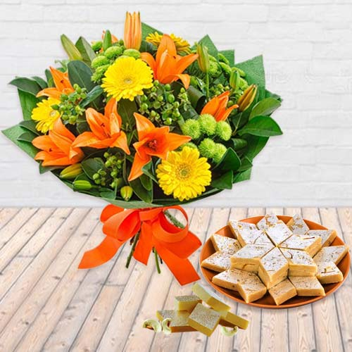 Splendorous Seasonal Flower bouquet along with yummy Kaju Barfi
