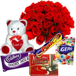 Small Teddy, Assorted Cadburys Chocolate and 12 Red Roses Bouquet