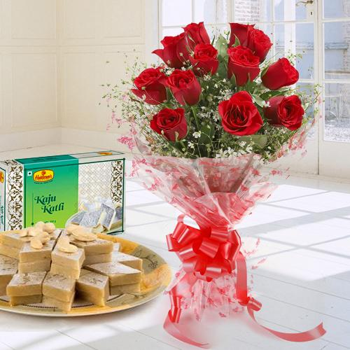 Impressive 1 dozen Red Roses and tasty Kaju Katli delight
