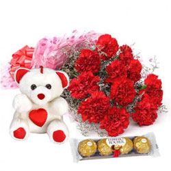 Ravishing Carnations Bouquet with Teddy N Ferreo Rocher