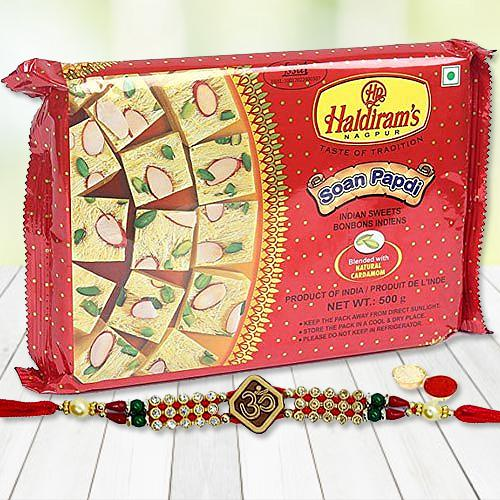 Mesmerizing Gift Set of Haldiram Soan Papri with Rakhi Roli Tika and Chawal for the Occasion of Raksha Bandhan