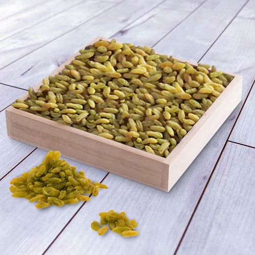 Tasty Raisins in a Wooden Tray