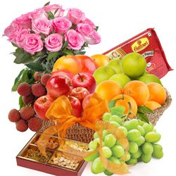 Nutritious Fresh Fruits Grandeur with Haldiram Soan papdi and Rose Bouquet