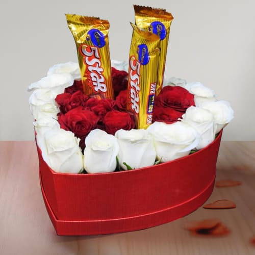 Beautiful Composition of Roses N Chocolates in Heart Box