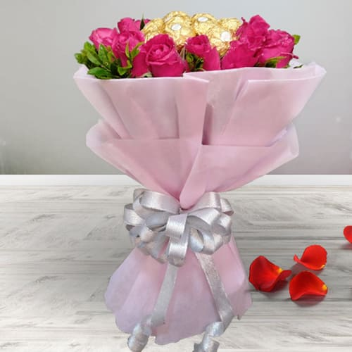 Beautiful Bouquet of Red Roses N Ferrero Rocher with Tissue Wrapping