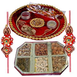 Amazing Rakhi Special Gift of Mixed Dry Fruits and Pooja Thali along with Rakhi for your Loving Brother